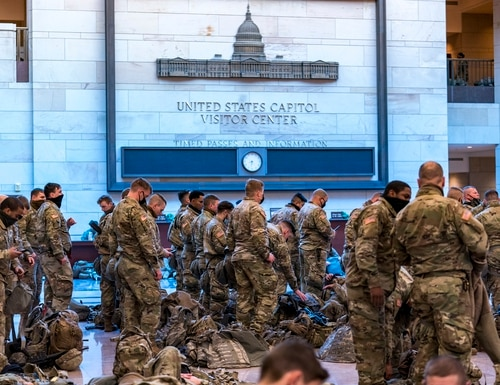 Hundreds of National Guard troops hold inside the Capitol Visitor's Center to reinforce security at the Capitol on Jan. 13, 2021. (J. Scott Applewhite/AP)