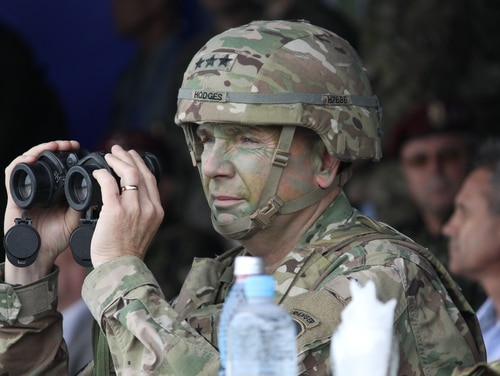 Lt. Gen. Ben Hodges, U.S. Army Europe commander, observes a combined-arms, live-fire exercise at the Joint National Training Center in Cincu, Romania. (Jen Judson/Staff)