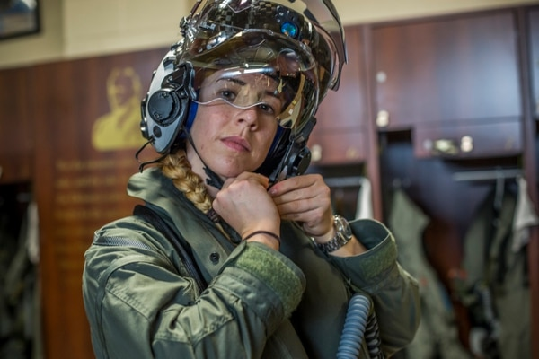 Capt. Anneliese Satz puts on her flight helmet prior to a training flight aboard Marine Corps Air Station Beaufort, March 11. Satz graduated the F-35B Lighting II Pilot Training Program June and will be assigned to Marine Fighter Attack Squadron 121 in Iwakuni, Japan. (Sgt. Ashley Phillips/Marine Corps)
