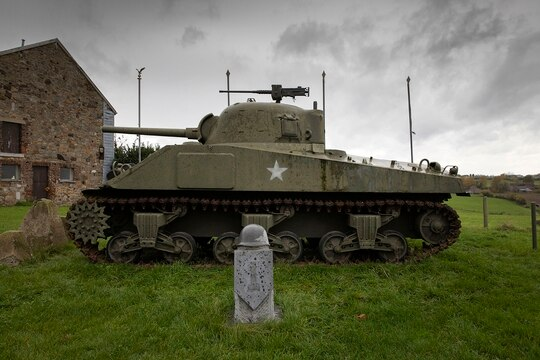 A U.S. Army World War II Sherman tank, similar to one being made available to drive as part of a unique initiative, sits on the hillside outside in Belgium. (Virginia Mayo/AP)