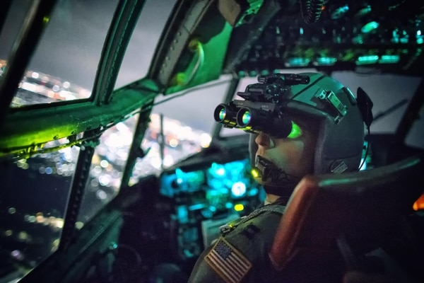 A C-130 Hercules pilot performs a visual confirmation with night vision goggles during a training mission over Japan, Oct. 14, 2015. Yokota Air Base aircrews regularly conduct night flying operations to ensure they're prepared to respond to a variety of contingencies throughout the Asia-Pacific region. (Osakabe Yasuo/Air Force)