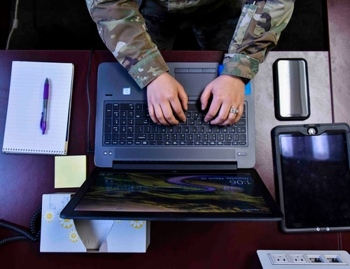 To mitigate the threat of COVID-19 to their workforce, the National Geospatial-Intelligence Agency is making it easier for its employees and contractors to work from home. (Airman 1st Class Kiaundra Miller/U.S. Air Force)