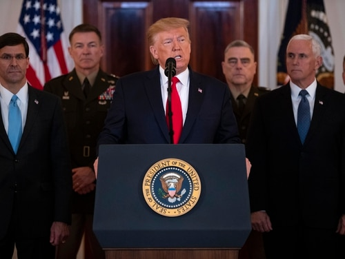 President Donald Trump addresses the nation from the White House on the ballistic missile strike that Iran launched against Iraqi air bases housing U.S. troops, Wednesday, Jan. 8, 2020, in Washington, as Secretary of Defense Mark Esper, Chairman of the Joint Chiefs of Staff Gen. Mark Milley, and Vice President Mike Pence, and others look on. (Evan Vucci/AP)