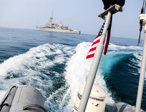A rigid inflatable boat attached to the U.S. Navy mine countermeasures ship Devastator performs maneuvers during small-boat operations. Devastator deployed to the U.S. 5th Fleet area of operations in support of Operation Sentinel. (Spc. Terrell Sherman/U.S. Army)