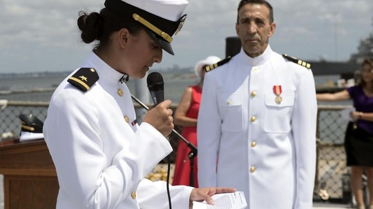 Ensign Laura Krause commissioned her 63-year-old father, heart surgeon Dr. Tyrone Krause, into the Navy Friday aboard the destroyer Ramage. (MCSN Will Hardy/Navy)