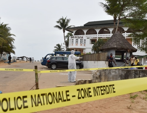 A police investigator walks in front of the Hotel Etoile du Sud in Grand Bassam, Ivory Coast, on March 14, 2016, a day after jihadist attackers stormed three hotels in the weekend resort. Ivory Coast ministers were to hold emergency talks on March 14 after the first jihadist attack in the country left 18 dead at a beach resort popular with foreigners, the latest such Islamist assault in West Africa. It was the third such attack in four months in West Africa and a blow to a nation working to lure back foreign tourists to its palm-fringed beaches and rainforests as it recovers from a brutal civil war. / AFP / ISSOUF SANOGO (Photo credit should read ISSOUF SANOGO/AFP/Getty Images)