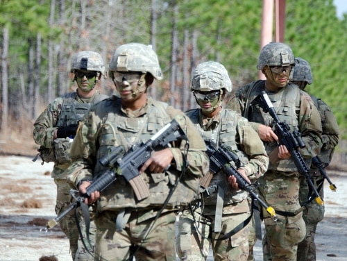 Basic trainees move in formation during the Forge, the final field training exercise of Army initial entry training, on Feb. 19 at Fort Jackson, S.C. (Army).