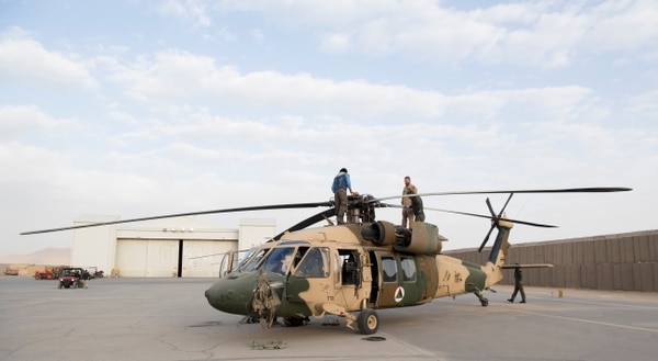 Afghan Air Force student pilots work with American contractor flying instructors on pre-flight checks on a UH-60 Black Hawk Dec. 8, 2018, in Kandahar, Afghanistan. (Staff Sgt. Clayton Cupit/Air Force)