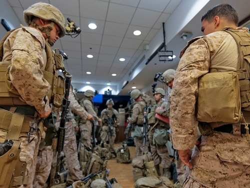 KUWAIT CITY, Kuwait (March 29, 2018) U.S. Marines, assigned to Fleet Anti-terrorism Security Team, Central Command (FASTCENT), check their gear prior to engaging in a crisis response exercise at the U.S. Embassy in Kuwait. ( Staff Sgt. Vitaliy Rusavskiy/Marine Corps)