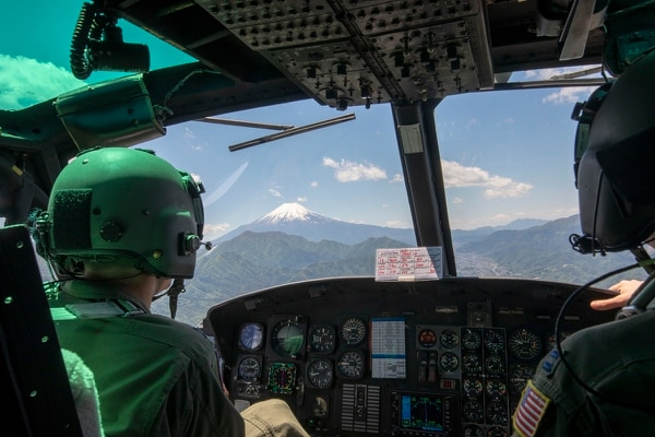 UH-1N Huey pilots from the 459th Airlift Squadron fly over Japan on May 4, 2018. A contract for the UH-1N replacement has been delayed to the end of fiscal year 2018. (Yasuo Osakabe/U.S. Air Force)