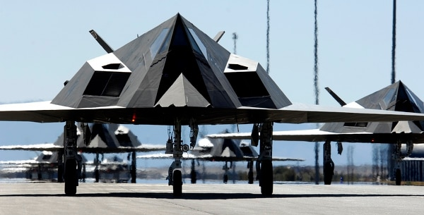 Twenty-five F-117 Nighthawks wait to take off from Holloman Air Force Base, N.M., in March 2008. The planes were part of a formation celebrating the Nighthawk's 25th anniversary/250,000 flying hour at Holloman. (Senior Airman Brian Ferguson/Air Force)