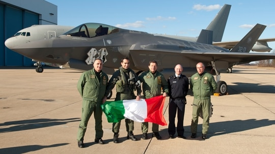 Italian Air Force personnel celebrate after an F-35A Lightning II aircraft made aviation history by completing the very first F-35 trans-Atlantic crossing, arriving at Naval Air Station Patuxent River, Md., from Cameri Air Base, Italy, on Feb. 5, 2016. (Andy Wolfe/U.S. Navy)