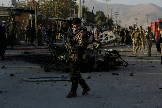 Afghan security personnel stand guard after a car bomb explosion in Kabul, Afghanistan,Tuesday, Oct. 27, 2020. (Mariam Zuhaib/AP)