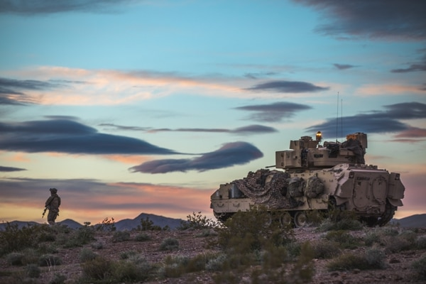An M2 Bradley Fighting Vehicle provides security for the 2nd Armored Brigade Combat Team, 1st Cavalry Division, as soldiers train at the National Training Center, Fort Irwin, Calif. (Maj. Carson Petry/Army)