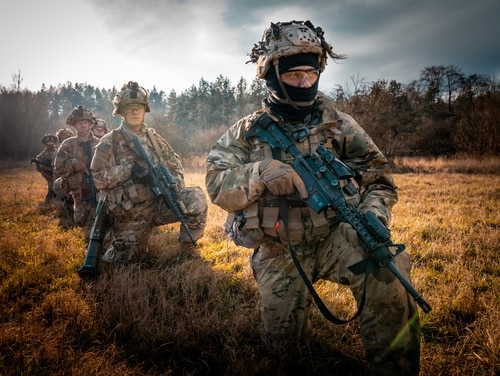 Paratroopers of the 173rd Airborne Brigade prepare to board a UH-60 Blackhawk of the 12th Combat Aviation Brigade, Wings of Victory, for a live-fire air assault during Operation Rock Frost on Dec. 9 at Grafenwöhr Training Area, Germany. (U.S. Army photo by Maj. Robert Fellingham)