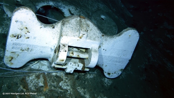 An image shot from a remotely operated vehicle shows the bottom of an anchor clearly marked