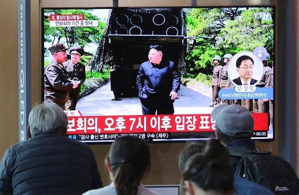 People watch a TV showing a file photo of North Korean leader Kim Jong Un, top center, during a news program at the Seoul Railway Station in Seoul, South Korea, Thursday, May 9, 2019. (Ahn Young-joon/AP)
