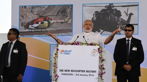 Indian Prime Minister Narendra Modi, center, gestures as he addresses the foundation stone-laying function of a helicopter manufacturing facility for state-owned Hindustan Aeronautics Limited. (Manjunath Kiran/AFP via Getty Images)