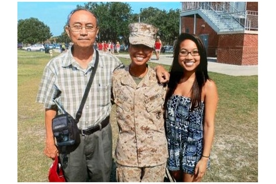 Marine Cpl. Thae Ohu, center, stands with her father Ahr Yu, left, and sister, Kay Yu, after she earned the title of Marine in 2013. (Courtesy of Pan Phyu)