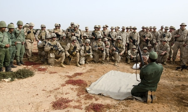 A platoon leader with Morocco's 6th Infantry Brigade instructs Marines on the assembly and disassembly of the AK-47 during the first day of African Lion 15, May 15, 2015. Marines with Alpha and Bravo Company, 1st Battalion, 25th Marine Regiment spent the day conducting marksmanship training and integrated weapons exchange with the Moroccan soldiers, focusing on the M4 and the AK-47. (Staff Sgt. Jared Gehmann/U.S. Army)