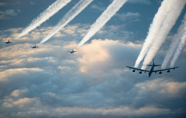 A B-52H Stratofortress, assigned to the 2nd Bomb Wing from Barksdale Air Force Base, Louisiana, and three Royal Norwegian Air Force F-16 Fighting Falcons fly together toward the Barents Sea region of the Arctic during Bomber Task Force 20-1, Nov. 6. (Staff Sgt. Trevor McBride/Air Force)