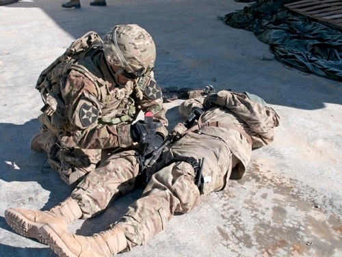 Sgt. Anthony Howard of 1st Squadron, 14th Cavalry Regiment, applies a tourniquet to a soldier during a unit readiness exercise held at Forward Operating Base Sweeney, Afghanistan, Jan. 20, 2012. (Staff Sgt. Christopher McCullough/Army)