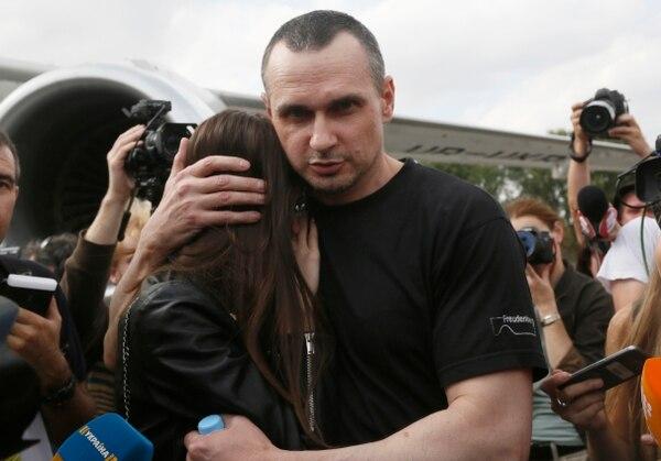 Ukrainian filmmaker Oleg Sentsov hugs his daughter upon his arrival at Boryspil airport, outside Kyiv, on Saturday. (Efrem Lukatsky/AP)