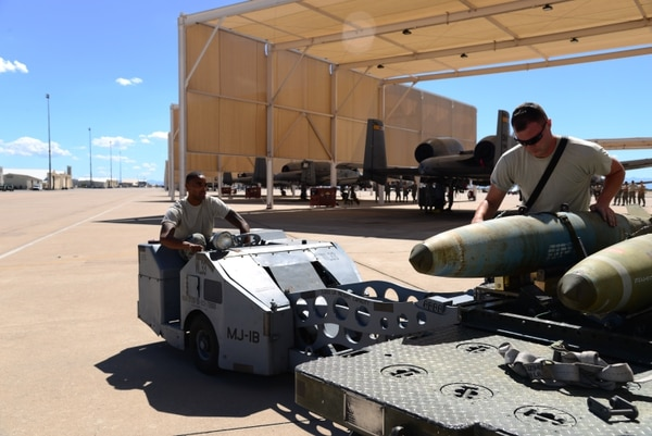 Staff Sgt. Joshua Terasas loads a GBU-31 joint direct attack munition at Davis-Monthan Air Force Base, Ariz. The military is planning to order 43,594 JDAMs in the 2019 budget to replenish stores depleted by the air campaign against the Islamic State. (Airman 1st Class Frankie D. Moore/Air Force)