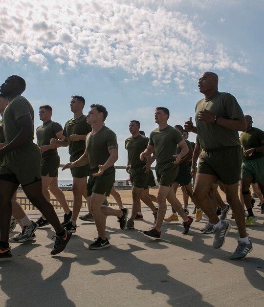 Sgt. Maj. Adam Moore calls cadence on a run with Marines in Virginia Beach, Virginia. (Cpl. Logan Snyder/Marine Corps)