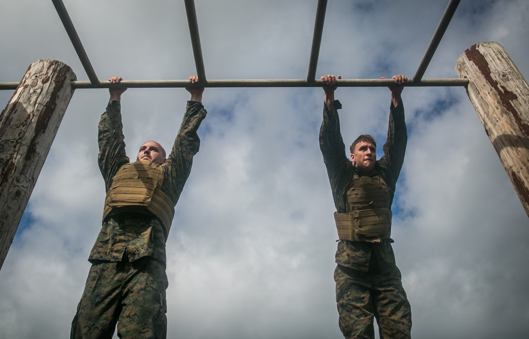 Sgt. Brett Rocca, from Little Rock, California and Cpl. Jeffrey Spangler, from Leavenworth, Kansas, both assigned to Martial Arts Instructor Course 1-17, work together to complete a obstacle course during a MAIC aboard Marine Corps Base Hawaii, Dec. 15, 2016. (Sgt. Brittney Vella/Marine Corps)