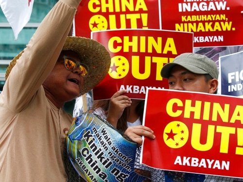 Protesters on June 11, 2018, shout slogans during a rally to protest the alleged continued seizure of catches of Filipino fishermen at a disputed shoal in the South China Sea in Manila, Philippines. (Bullit Marquez/AP)