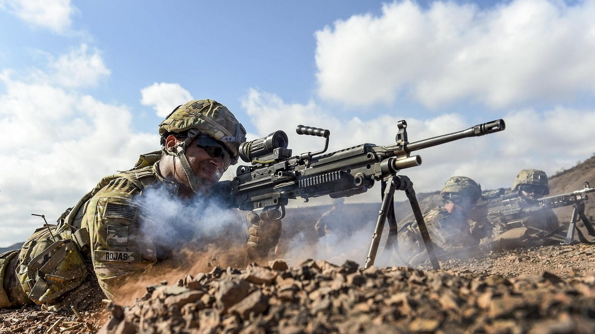 1060c58130 ... an M249 light machine gun during small arms training in Arta, Djibouti,  May 2, 2017. The Army is looking to replace the M249 squad automatic weapon  with ...