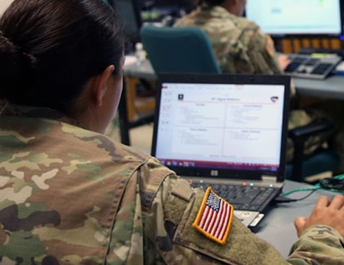 U.S. Army soldiers assigned to the 44th Expeditionary Signal Battalion, 2nd Theater Signal Brigade, monitor the network at Lightning Ops, the Theater Network Operations Center for Exercise Saber Guardian 17, in June 2017 in Romania. (U.S. Army)