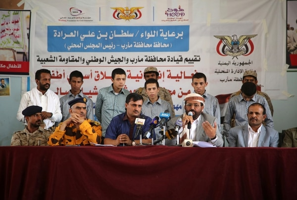 Marib's Governor Sultan al-Arada (bottom-2ndR) speaks on June 7, 2016 in the city of Marib, east of the capital, after young Huthi fighters were released by the Saudi-backed government. The UN envoy for Yemen had been trying to push the two sides to agree to release half of all their prisoners before Ramadan, which began on June 6, 2016. / AFP / ABDULLAH AL-QADRY (Photo credit should read ABDULLAH AL-QADRY/AFP/Getty Images)