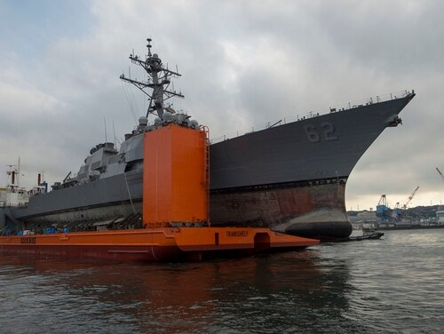 The destroyer Fitzgerald departs Pier 9 at Fleet Activities Yokosuka, Japan, in December 2017, to be transported to Huntington Ingalls Industries in Pascagoula, Miss., for repairs. (MC1 Benjamin Dobbs/U.S. Navy)