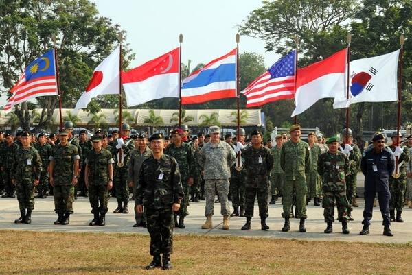 Members from various participating nations of Exercise Cobra Gold 2014 stand in formation Feb. 11, 2014, during the opening ceremony at Camp Akatosarot, Thailand. (Spc. Tyler Meister/Army)
