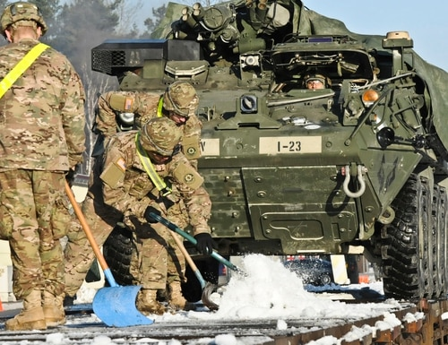 2nd Cavalry Regiment soldiers load Strykers to be transported by train during Operation Atlantic Resolve in January 2015 at Rose Barracks, Germany.