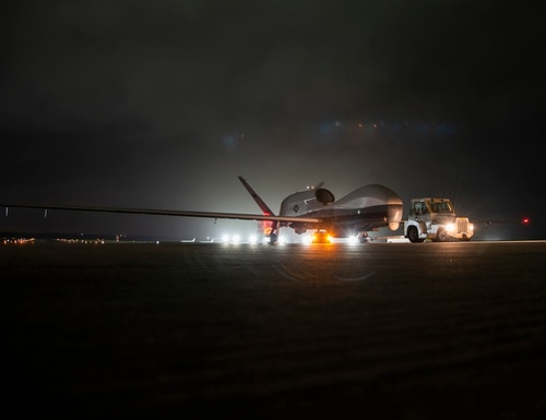 An MQ-4C Triton unmanned aircraft system idles on a runway at Andersen Air Force Base after arriving for a deployment as part of an early operational capability test to further develop the concept of operations and fleet learning associated with operating the drone. (MC3 MacAdam Kane Weissman/U.S. Navy)