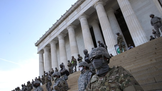 Members of the D.C. National Guard stand on the steps of the Lincoln Memorial in Washington as demonstrators participate in a peaceful protest against police brutality and the death of George Floyd. (Win McNamee/Getty Images)