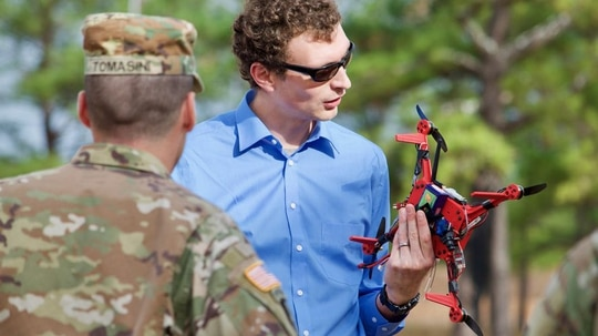 An Army researcher demonstrates a 3-D printed drone.