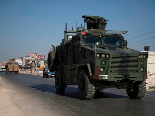 A Turkish army convoy drives along the Bab al-Hawa highway on Aug. 24, 2019, on its way to reinforce a Turkish military observation point in northwestern Syria. (Aaref Watad/AFP via Getty Images)