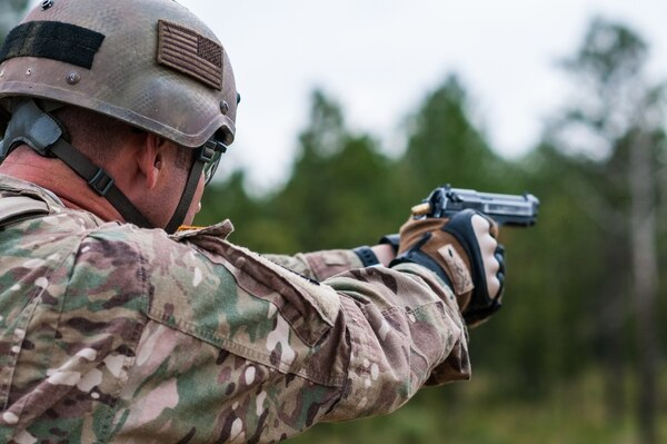 Master Sgt. Russell Moore, with the 416th Theater Engineer Command and a member of the U.S. Army Reserve Marksmanship Team, engages targets with his M9 pistol during the Dot Torture event on the final day of the U.S. Army Forces Command Weapons Marksmanship Competition Sept. 23, 2015, at Fort Bragg, N.C. The three-day FORSCOM competition features 27 marksmen from the U.S. Army, U.S. Army Reserve and the National Guard in events for the M9 pistol, the M4A1 rifle and the M249 SAW, or Squad Automatic Weapon, to recognize Soldiers who are beyond expert marksmen. The multi-tiered events challenge the competitors' ability to accurately and quickly engage targets in a variety of conditions and environments. (U.S. Army photo by Timothy L. Hale/Released)