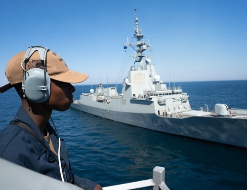 Seaman Nakia Hardy stands lookout during a simulated towing exercise with Álvaro de Bazán (F101) onboard the guided-missile destroyer Porter (DDG 78) while participating in Exercise Sea Breeze 2020 on July 21, 2020. (Interior Communication Electrician 2nd Class Jeffrey Abelon/Navy)