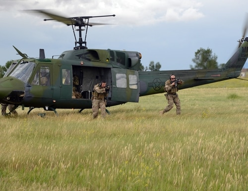 Tactical Response Force Airmen from the 741st Missile Security Forces Squadron, practice a quick departure from a UH-1N Iriquois July 6, 2016, at Malmstrom Air Force Base, Mont. The 40th Helicopter Squadron aircrew and the TRF Airmen conduct day and night infiltration and exfiltration training. (U.S. Air Force photo/Staff Sgt. Delia Marchick)