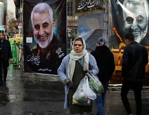 Pedestrians walk past banners of Iranian Revolutionary Guard Gen. Qassem Soleimani, who was killed in Iraq in a U.S. drone attack on Friday, in Tajrish square in northern Tehran, Iran, Thursday, Jan. 9, 2020. (Vahid Salemi/AP)