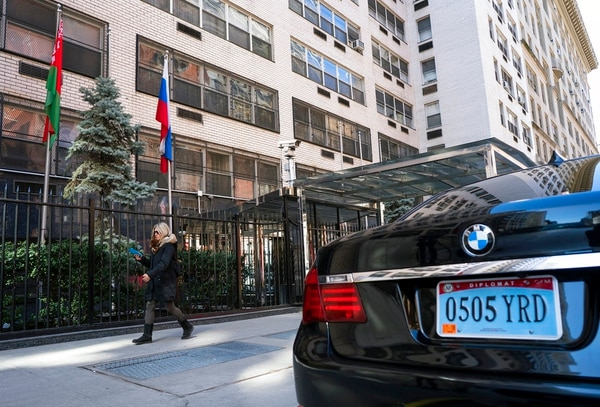 A woman walks past the Permanent Mission of the Russian Federation in New York Monday, March 26, 2018. The United States and more than a dozen European nations kicked out Russian diplomats on Monday and the Trump administration ordered Russia's consulate in Seattle to close, as the West sought joint punishment for Moscow's alleged role in poisoning an ex-spy in Britain. (Craig Ruttle/AP)