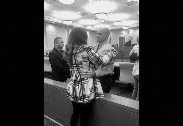 Mrozek embraces his fiancé after the jury verdict was announced. (Beau Powell)