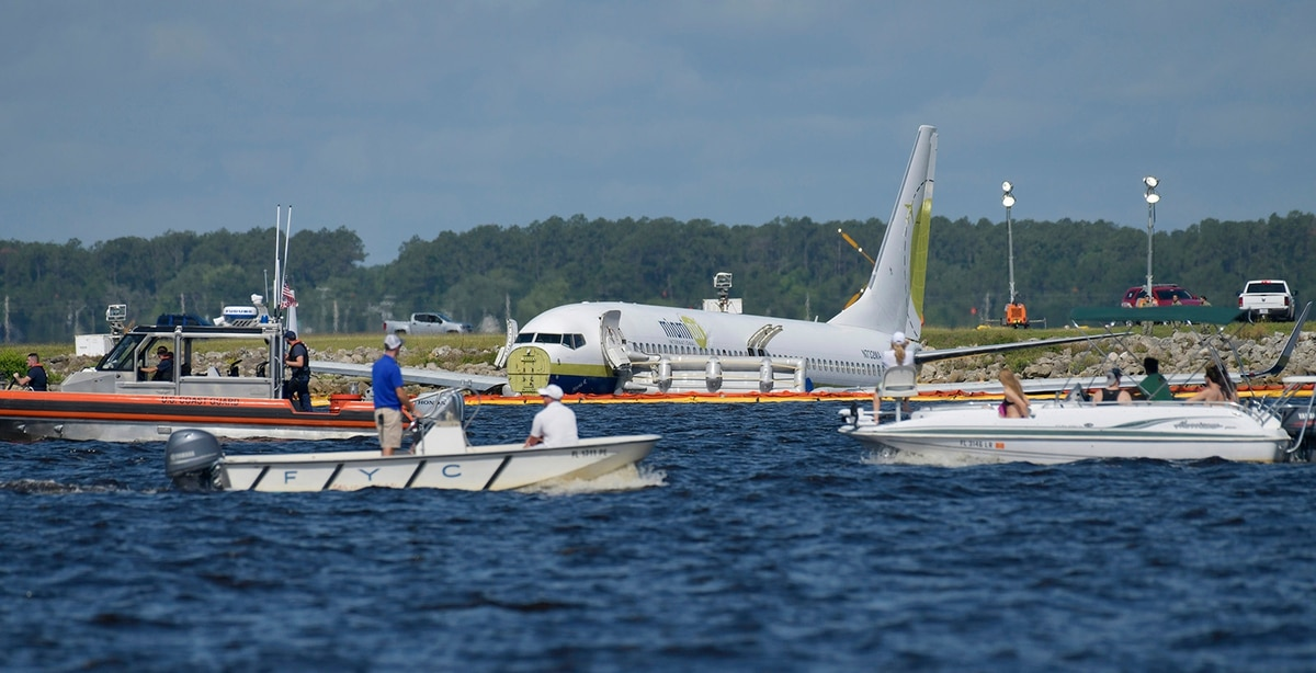 Airline sued after chartered jet skids into Florida river at NAS