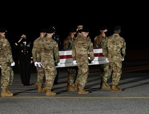 A U.S. Army carry team transfers the remains of Spc. Nick Bravo Regules of Largo, Florida, during a dignified transfer June 27, 2020, at Dover Air Force Base, Delaware. Bravo Regules was assigned to 2nd Battalion, 43rd Air Defense Artillery Regiment, 11th Air Defense Artillery Brigade, Fort Bliss, Texas. (U.S. Air Force photo by Senior Airman Eric M. Fisher)