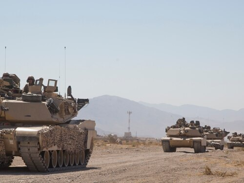 U.S. Soldiers assigned to 1st Battalion 8th Infantry, 3rd Brigade Combat Team, 4th Infantry Division assemble in preparation before maneuvering through enemy territory utilizing M1 Abrams tanks during Decisive Action Rotation 16-09 at the National Training Center in Fort Irwin, Calif., Sept. 8, 2016. (U.S. Army photo by Spc. Arnell Ord, National Training Center/ Operations Group)